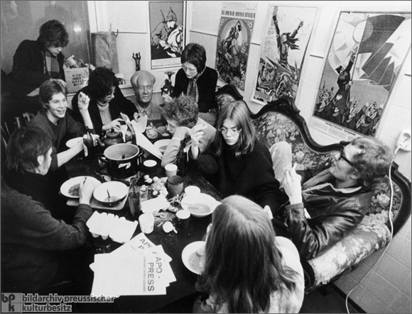 West German youth in a political commune eating a meal (1968)