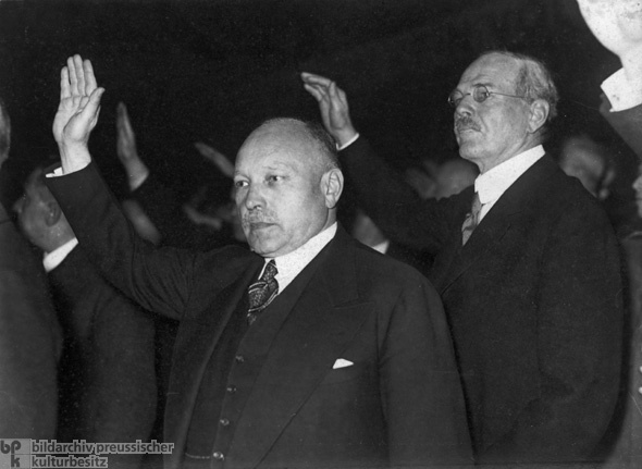 <span>German Industrialists Salute the Flag at a Rally for the German Economy in Berlin</span>(1933)