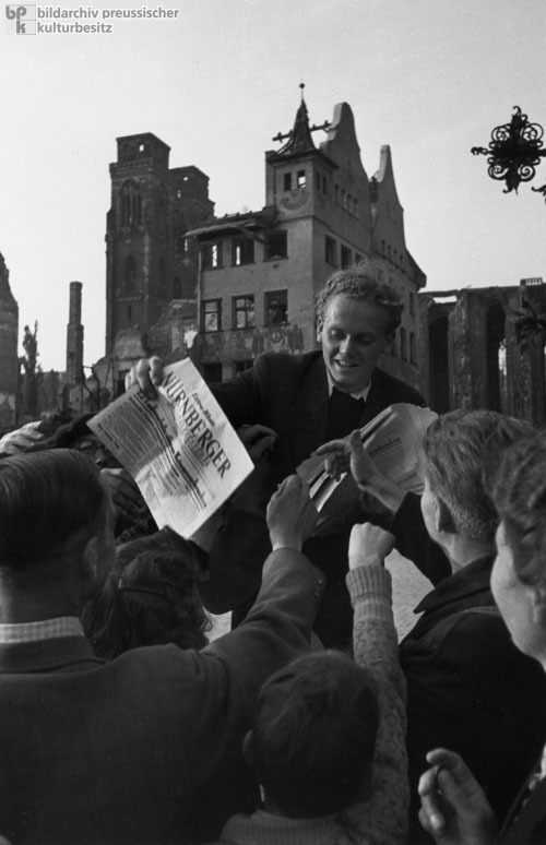 Nuremberg Residents Wait Eagerly for a Copy of the Newspaper that Contains the Nazi War Crime Trials (1946)