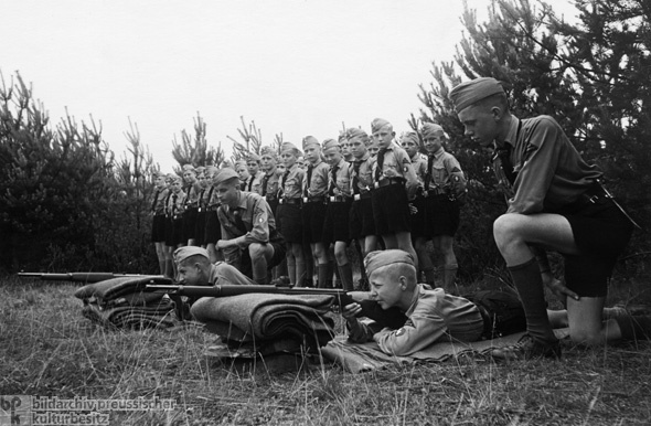 Members of the Hamburg Jungvolk are Instructed in the Use of Carbine Rifles at a Hitler Youth Camp on the Baltic Sea (1938)