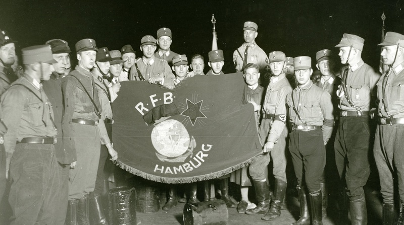 SA members with the captured flag of the Communist paramilitary, the Red Front Fighters Alliance (Roter Frontkämpferbund)